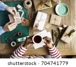 hands wrapping present gift box ... | Shutterstock . vector #704741779