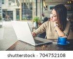 young beautiful asian woman... | Shutterstock . vector #704752108