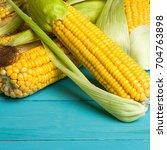 ripe yellow sweet corn cob on a ... | Shutterstock . vector #704763898