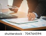 a businessman analyzing... | Shutterstock . vector #704764594