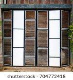 Small photo of Beautiful wooden accordion door