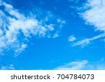 blue sky with clouds  | Shutterstock . vector #704784073