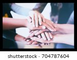team teamwork join hands... | Shutterstock . vector #704787604