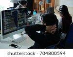 pensive programmer looking at... | Shutterstock . vector #704800594