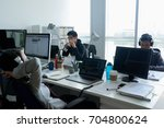 team of young asian programmers ... | Shutterstock . vector #704800624