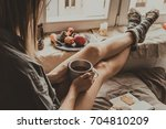 cozy home. woman with cup of... | Shutterstock . vector #704810209