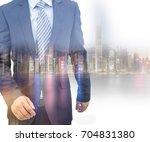 double exposure of businessman... | Shutterstock . vector #704831380