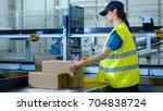 postal sorting office workers... | Shutterstock . vector #704838724