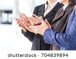 business people clapping hands... | Shutterstock . vector #704839894