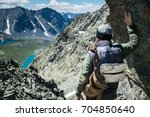 hiker standing on the cliff... | Shutterstock . vector #704850640
