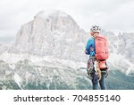 female mountaineer with... | Shutterstock . vector #704855140