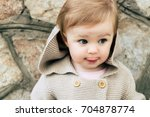 autumn baby portrait in warm... | Shutterstock . vector #704878774