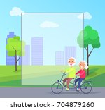 happy mature couple riding... | Shutterstock .eps vector #704879260