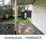 Small photo of Moe, Victoria, Australia 08/29/2017. Old Gippstown Gippsland Heritage Park. Bushy Park Homestead veranda showing outhouse (toilet) in the background