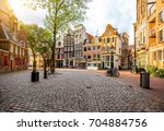 Morning view on the square with beautiful buildings near the Old Church in Amsterdam city