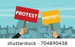 hand holding protest sign flat... | Shutterstock .eps vector #704890438