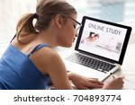 shoulder view of young woman in ... | Shutterstock . vector #704893774