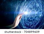 hand with zodiac sign horoscope ... | Shutterstock . vector #704899609