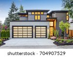 luxurious new construction home ... | Shutterstock . vector #704907529