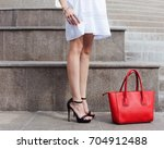 a fashionable girl poses after... | Shutterstock . vector #704912488