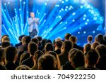 audience listens to the... | Shutterstock . vector #704922250