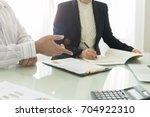 administrator team analyze data ... | Shutterstock . vector #704922310