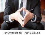 cropped view of boss holding... | Shutterstock . vector #704928166