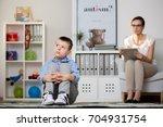 psychologist in glasses is... | Shutterstock . vector #704931754