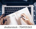 top view of businesswoman hands ... | Shutterstock . vector #704935363