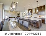 open plan kitchen equipped with ... | Shutterstock . vector #704943358