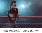 woman practices martial arts | Shutterstock . vector #704955079