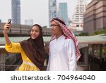 aarab businessman and... | Shutterstock . vector #704964040