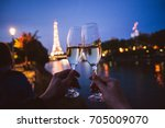 two people wining with... | Shutterstock . vector #705009070