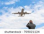 aircraft spotting concept. man... | Shutterstock . vector #705021124