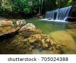 fresh views of the waterfalls... | Shutterstock . vector #705024388
