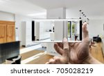 two hands holding a mobile... | Shutterstock . vector #705028219