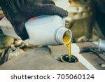 engine oil change | Shutterstock . vector #705060124