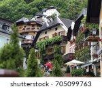 town hallstatt with mountain... | Shutterstock . vector #705099763