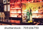 making cocktail in a bar | Shutterstock . vector #705106750