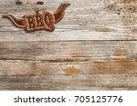 bbq sign hung on a wooden wall   Shutterstock . vector #705125776