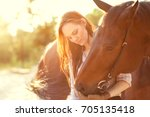 Girl Hugging With A Horse At...