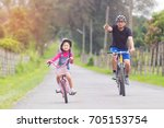 asian father and daughter... | Shutterstock . vector #705153754