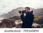 handsome man with digital...   Shutterstock . vector #705160894