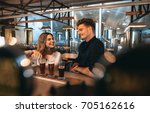 young man and woman at the bar... | Shutterstock . vector #705162616