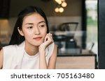 a portrait of a beautiful asian ... | Shutterstock . vector #705163480