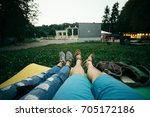 couple lies on the ground and... | Shutterstock . vector #705172186