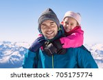young daughter riding piggyback ... | Shutterstock . vector #705175774