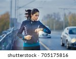 young fitness woman runner... | Shutterstock . vector #705175816