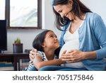 lovely daughter touching mother'...   Shutterstock . vector #705175846