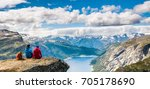 couple sitting against amazing... | Shutterstock . vector #705178690